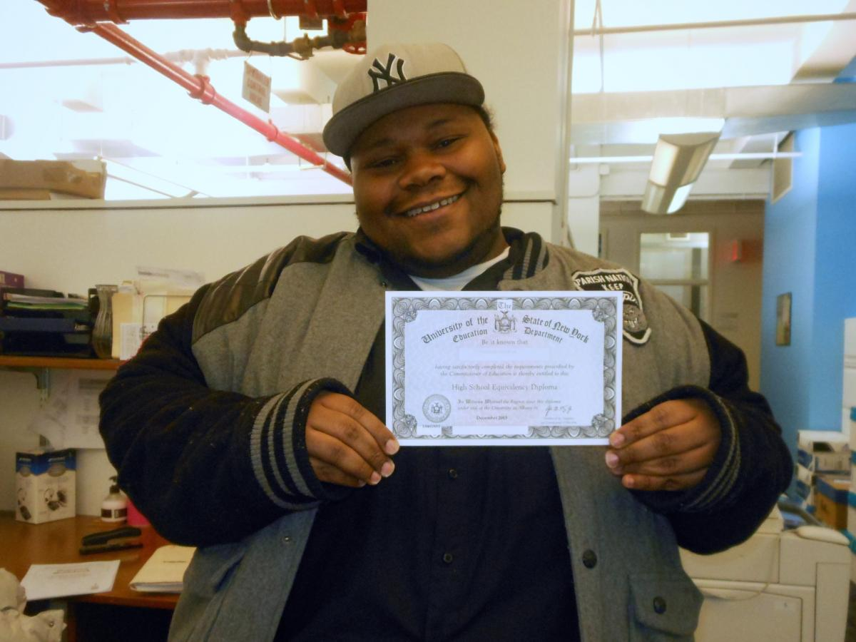 josh with his GED diploma